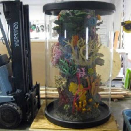 672 gallon acrylic cylinder tank. New price 1000 less - $3900 (Okauchee, WI)